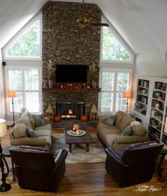 the challenge with your living room is how dark it is. If the fireplace wall is not the western wall it would be AWESOME to put in triangular glass like this above the existing windows - other option - taller windows.