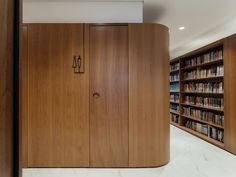Image 21 of 29 from gallery of Silveiro Lawyers Office / Estúdio BG + LVPN Arquitetura. Photograph by Cristiano Bauce Bathroom Signage, Lawyer Office, Timber Cladding, Office Workspace, Contemporary Interior, Tall Cabinet Storage, Interior Design, Gallery, Lawyers