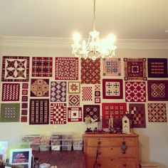 Inspired by Kathie's  and Leah's walls of quilts, it has been a dream of mine  to  also have a wall of mini quilts as part of my se...