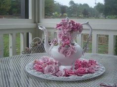 SILVER TEA POTS PAINTED A SHABBY WHITE THEN ADORNED WITH VINTAGE BROOCHES PEARLS AND RHINESTONES. EACH POT IS DIFFRENT IN SIZE .