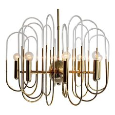 Gaetano Sciolari Brass and Glass Chandelier | From a unique collection of antique and modern chandeliers and pendants at https://www.1stdibs.com/furniture/lighting/chandeliers-pendant-lights/