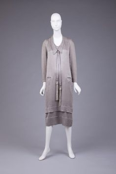 Street length silk dress with side buttons and tassels, c1924