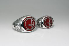 Two silver signet rings with red enamel