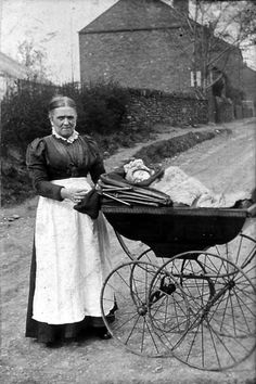 Baby in a Victorian pram.  Prams were first seen around 1850 and became very fashionable throughout the Victorian era. They were seen as a status symbol because they were costly.