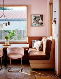 Kitchen nook with pink walls and pink chairs