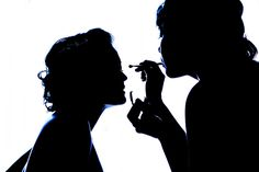 very cool silhouette of a bride getting ready