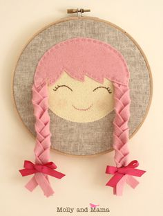 """""""Miss Amelia"""" Hoop Art - Make this wool felt dolly face appliquéd on linen using the 'Doll Face' applique template from Molly and Mama. Substitute the pigtails in the pattern for felt plaits instead. So cute! So easy!"""