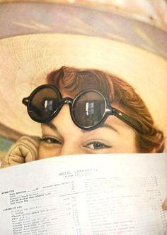 Jean Patchett hiding behind a menu card....Irving Penn for Vogue May 1949