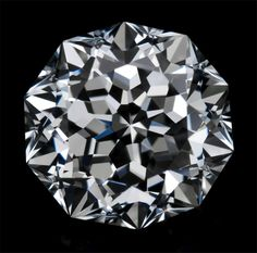 Lustig's Exclusive Meteor cut diamond. 71 faceted decagonal shape. Flawless symmetry, each facet perfectly angled so that it radiates dazzling brilliance.