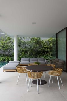 Boho Patio Design - Flamenco House by BZP Architecture A modern patio that uses boho design. It offers modish and comfy sectional sofa and daybed. The rou Patio Design, Sofa Design, Round Coffee Table Sets, Comfy Sectional, Light Green Walls, Cozy Patio, Outdoor Dining, Outdoor Decor, Wicker Chairs
