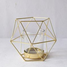 Geometric Gold Candle Holder (Small) Create an artful lighting display with this candle holder. With its geometrical pattern, this candle holder is the perfect addition to any contemporary home decor palette. Design Candle Holders, Geometric Candle Holder, Gold Candle Holders, Gold Candles, Candlestick Holders, Candlesticks, Home Decor Items Online, Golden Decor, Beautiful Candles