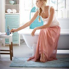 cute bathroom and i love what she wears.