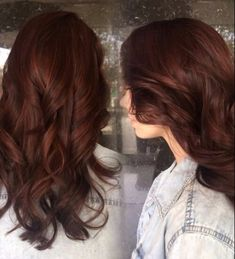 Auburn hair color brunette with subtle red highlights peaking through
