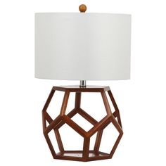 Cast a stylish glow over your bedside or favorite reading nook with this eye-catching table lamp, featuring an openwork wood base with a geometric silhouette.
