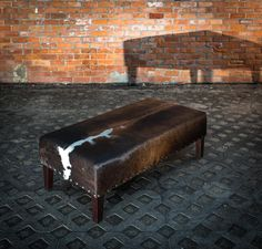Sherlock Ottoman A Beautiful Cowhide Coffee Table Featuring Antique Copper Studs This Could