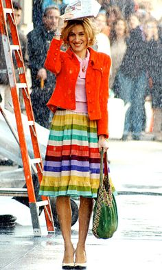 celeb trend Carrie SATC bright orange cropped jacket and rainbow skirt - 50 Best Carrie Bradshaw Fashion Moments | InStyle UK