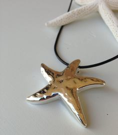 Silver plated starfish pendant on leather cord on Etsy, $25.00