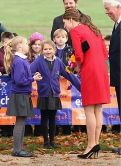 @ETCanada: Photo: Lady in Red! Duchess Of Cambridge Meets School Children At A Hospice In Norfolk