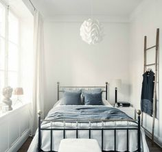 Rustic modern Scandinavian bedroom. White and light blue help open up the small space.