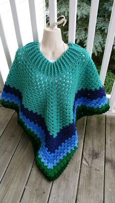 Hot Off My Hook! Project: Cowl-Neck Poncho Started: 16 June 2015 Completed: 19 June 2015 Model: Madge the Mannequin Crochet Hook(s): J, Cowl portion, J, Granny stitch portion, K, Border Yarn: Redheart Super Saver Color(s): Jade, Soft Navy, Blue, Delft Blue, Paddock Green & Hunter Green Pattern Source: Simply Crochet Magazine Issue No. 25 Pattern Design: Simone Francis Notes: This my 6th Cowl-Neck Poncho! I shortened the cowl portion.