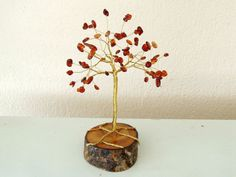 Your place to buy and sell all things handmade Wire Tree Sculpture, Survival Instinct, Wire Trees, Handmade Wire, Garnet Gemstone, One And Other, Red Garnet, Heart Chakra, Tree Of Life