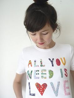 cute applique tee...I could see doing this with old shirts or leftover fabric!  Always thinking of how I can repurpose.  :)
