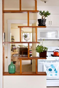 20 Captivating Mid Century Modern Living Room Design Ideas 20 Captivating Mid Century Modern Living Room Design Ideas Danijela Schulz Danijela Schulz Mid century modern design looks like a perfect combination They have some hellip Living Room Kitchen Partition, Living Room Divider, Living Room Plants, Diy Room Divider, Room With Plants, Room Dividers, Bookshelf Room Divider, Small Room Divider, Living Room Shelves