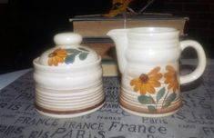 Vintage (1970s) cream and covered sugar bowl. Hand-painted and made in German Democratic Republic (GDR).  Flowers, brown bands.