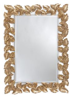 """Autumn leaves"" A cascade of meticulously hand carved autumn leaves, delicately framing a rectangular pane. This fabulous mirror frame is available with vertical and horizontal hanging options."