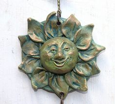 Paper Clay Sun Face  from Flicker; cadeswelkin's photostream  Finished with Baroque waxes, or Gilders paste.