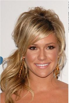 This is a great look as Kristin Cavallari has her long thick hair styled into this off to the side ponytail. There is lots of volume to this hairstyle as Kristin has her hair built up high at back. Bangs come down onto the forehead while at back, her long curly hair has been gathered together for this style.The hair is cut long.This hair colour is dark blonde.