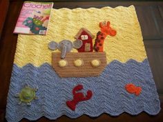 "Noah's Ark crocheted blanket, love this! I left the ""ark"" open and put in 3 little stuffed animals though :)"