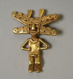 Gold Figure Pendant    Date:      5th–10th century  Geography:      Colombia  Culture:      Quimbaya or Sinu (?)  Medium:      Gold  Dimensions:      H. 1 3/4 x W. 1 3/8 x D. 3/8 in. (4.4 x 3.5 x 1 cm)  Classification:      Metal-Ornaments
