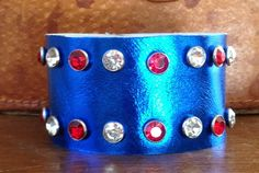 SUPER HERO BLUE metallic leather cuff bracelet with red and clear crystals by whackytacky, $29.99