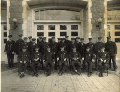A crew of firemen outside of Central Fire Station. Date of the photo is unknown but the station was built in 1912.