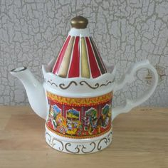 Check out this item in my Etsy shop https://www.etsy.com/listing/274733724/carousel-tea-pot-vintage-tea-server