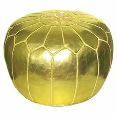"""Handmade leather pouf in gold.Product: PoufConstruction Material: Genuine leather and shredded foam fillColor: GoldFeatures:    Handmade in MoroccoCan be used as an ottoman or extra seating  Dimensions: 12"""" H x 21"""" Diameter"""