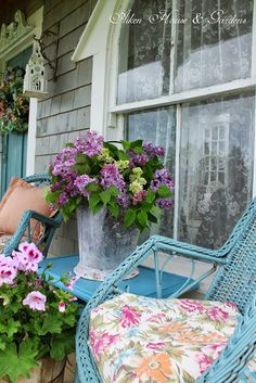 Pretty porch - blue wicker, bucket of cut lilacs, geraniums, birdhouse - Aiken House & Gardens Cottage Living, Cozy Cottage, Cottage Style, Cottage Patio, Shabby Cottage, Cottage Homes, Porches, Dream Garden, Home And Garden