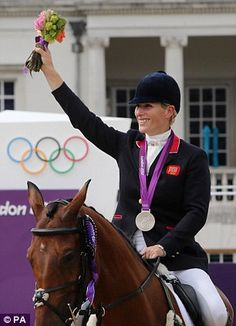 Parading: Zara Phillips shows off her silver medal