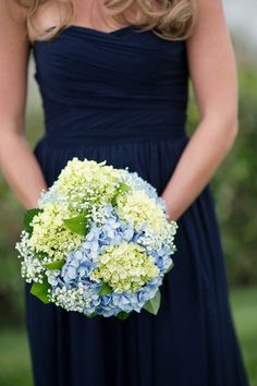Green and blue hydrangeas, babies breath, and contrasting navy. <<-- the greenish white hydrangeas i think are what we looked at at publix ..