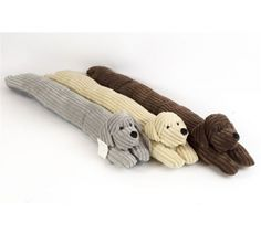 Dog draught excluder in super-soft ribbed fabric for only £12.95. This dog will protect your room from draughts as well as being super-cuddly! Available in a choice of three colours; Beige, Chocolate and Grey.    W90 x D13 x H13cm    Can be kept company through the day by the Ribbed Dog Door Stop if being left alone.