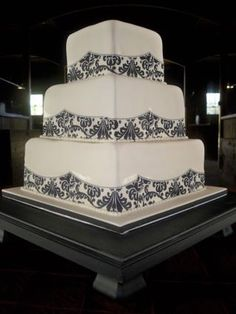 Maples Wedding Cakes. I love how the damask doesn't overpower the cake.