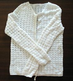 My lace fabric sweater pattern is a great addition to your wardrobe of winter clothes.  This beautiful jacket is worked in a white lace design that will complement many outfits.