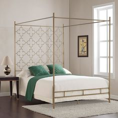 Beautiful quatrefoil metal designs accentuate the headboard of this beautiful queen bed. A scratch and mar resistant brushed goldtone powder coat finish and canopy design give this gorgeous bed a retro Hollywood glam era feel.