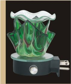 Wall Plug-in Electric Lamp Tart and Oil Warmer BCE-871098FG by Bucketcart. $23.50. This beautiful oil-warmer brings a wonderful fragrant to any room. Plug it in your bathroom, kitchen, bedroom, or living room and let the smell fill the room. Place a few drops of scented oil or a scented tart on the glass dish, and your room will be filled with an amazing aroma. Electric oil warmers use a halogen bulb to heat the scented oils, which are much safer than using a te...