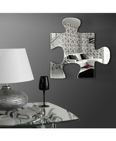 Jigsaw Acrylic Mirror $23.99.  Comes with adhesive mountings for easy installation