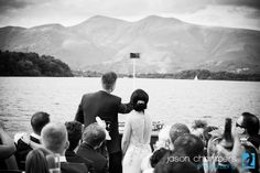 Ash & Dom on the Keswick Launch around Derwent Water, part of their beautiful wedding at The Lodore Falls Hotel