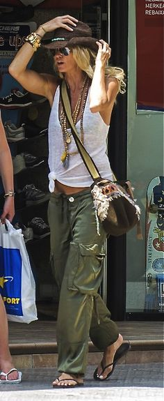 Elle Macpherson--love the necklaces on such a simple informal outfit. Awesome!