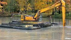 http://ak6.picdn.net/shutterstock/videos/2375225/preview/stock-footage-st-petersburg-sept-dredging-machine-deepening-the-river-bottom-on-september-in-st.jpg