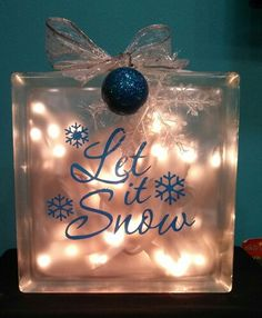 Created by Anne's Art & Vinyl creations, custom glass blocks with or without lights.  Let it Snow, decoration, lighted glass block, find me on Facebook!